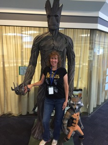 Author Stacey Longo hanging out with Groot and Rocket.